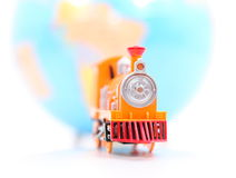 Toy Train and Globe. On white background Royalty Free Stock Photo