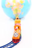 Toy Train and Globe. On white background Stock Photo