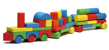 Toy train goods van, wooden blocks cargo railway transportation Royalty Free Stock Photography