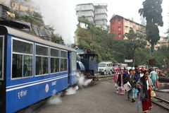 Toy train and local people. The Darjeeling Himalayan Railway, nicknamed the Toy Train, is a 2 ft (610 mm) narrow-gauge railway from Siliguri to Darjeeling Stock Photos