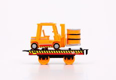 Toy Train & Machines. Toy train carrier on white background Royalty Free Stock Photography