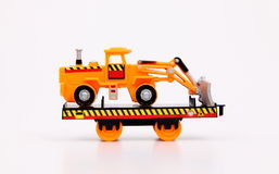 Toy Train & Machines. Toy train carrier on white background Stock Photos