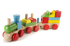 Toy train made from wood. With colorful blocs stock photo