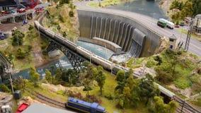 Toy train models on railroad set mockup - passenger trains