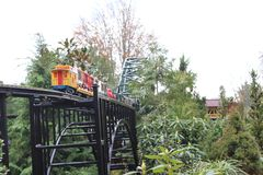 Toy Train Outdoors. A small train in the outdoors for families to gather an enjoy some outdoor time royalty free stock image
