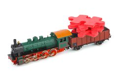 Toy train with puzzle Royalty Free Stock Photos