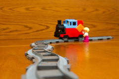 Toy train Rails, people. The toy train goes on rails. On a brown background Stock Images