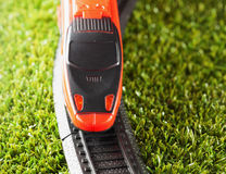 Toy train. Red toy train running over, strict close up Stock Image