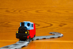 A toy train rides on rails Royalty Free Stock Photo