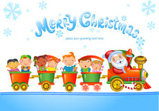 Toy train with Santa Claus and kids. Royalty Free Stock Photo