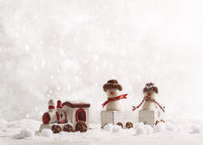 Toy Train Set. Carrying snowmen in winter setting Royalty Free Stock Images