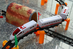 Toy Train Setup. A photo taken on a setup of a toy train assembly with rails and boulder tunnel Royalty Free Stock Photo