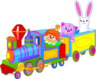 Toy train and toys. Toy train. Clown, cat and bunny sitting in the train Stock Photography