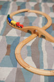 Toy train track. Wooden toy train track on carpet Royalty Free Stock Image