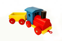Toy train with a trailer. Colorful wooden toy train with a trailer isolated in white Royalty Free Stock Photo