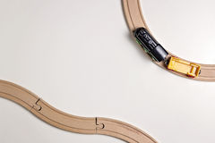 Toy train and wooden rails on white background. Top view. Copy space for text Royalty Free Stock Photography
