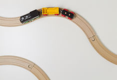 Toy train and wooden rails on white background. Top view. Copy space for text Stock Images