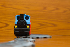 Toy trainon rails. Front view Royalty Free Stock Photos
