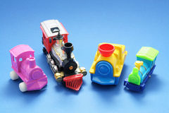 Toy Trains. On Blue Background stock photography