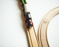 Toy trains. Wooden toy trains on tracks stock photography