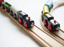 Toy trains. Wooden toy trains on tracks stock images