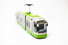 Toy tram. A toy tram isolated on a white background. Diagonal view Stock Photo