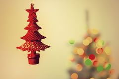 Red toy tree on the background of a Christmas tree. Toy tree on the background of a Christmas tree stock photos