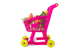 A toy trolley with vegetables. In isolated white background Royalty Free Stock Images
