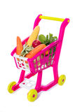 A toy trolley with vegetables. In isolated white background Royalty Free Stock Photo