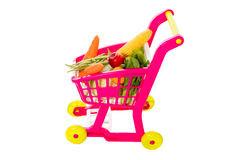 A toy trolley with vegetables. In isolated white background Stock Photo