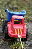 TOY TRUCK. Dirty toy truck on the mud Stock Photo