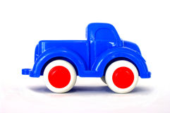 Toy truck. A bright blue toy truck with white tyres and red wheels Stock Photography