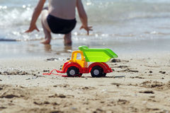 Toy truck on the beach Royalty Free Stock Image