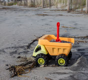Toy truck on the beach. Yellow Toy truck on the beach Royalty Free Stock Photo