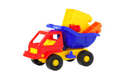Toy truck with building cubes. Isolated Stock Photo