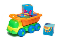 Toy truck carrying bricks. Colorful toy truck carrying bricks Stock Photos