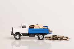 Toy truck with coins Royalty Free Stock Photo