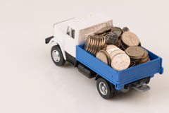 Toy truck with coins two Stock Photos
