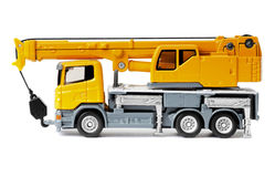 Toy truck crane. Yellow toy truck crane isolated over white backgroung Royalty Free Stock Photos