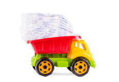 Toy truck with diaper. Isolated on white background Stock Photos