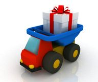Toy truck drives a gift Stock Photography