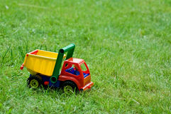 Toy truck on grass. Closeup of toy tipper truck on grass with copy space Stock Photography