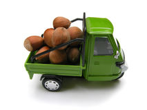 Toy truck with hazelnuts Stock Image