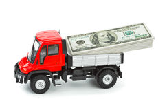 Toy truck with money Stock Image