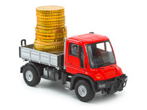Toy truck with money Royalty Free Stock Images