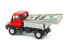 Toy truck with money Royalty Free Stock Photo