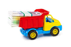 Toy truck with money Royalty Free Stock Image