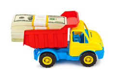 Toy truck with money Royalty Free Stock Photography