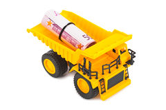 Toy truck with money Royalty Free Stock Photos