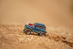 Toy truck offroading on mud with soft focus and beautiful bokeh Royalty Free Stock Photo